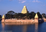 gopurams of indian temples with the golden light of the sunset