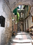 view from above of an alley in dolceacqua italy ligury with houses and shops