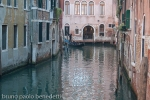 romantic glimpse in venice with gondola and ancient buildings