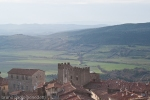 view from massa marittima with historic city center on misty maremma hills in tuscany