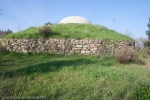 view from outside of Etrurian grave in Italy with dome on small hill
