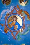 icon of Jesus Christ on a vault in Georgian orthodox church in blue color dominant with inscription in Georgian alphabet